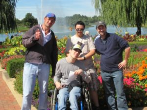 Four participants outside in Botanic Gardens on sunny day