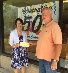 Executive Director Ann receives 2018 fundraiser check from Dennis at Gigio's Pizzeria.