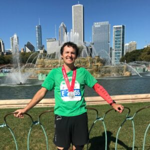 Chicago Marathon Team CIF runner in front of Chicago skyline