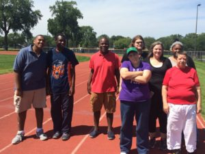 8 members of Life Tools Camp at a track field