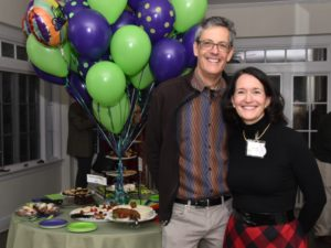 Executive Director Ann and Board co-chair Jeff smile at Something's Cooking.