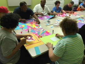Members of Art Club working with a great volunteer honored during Volunteer Appreciation Month