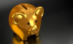 A gold piggy bank against a dark background
