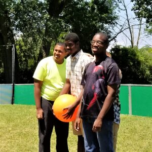 Transition students smile during game of kickball at Life Skills Camp