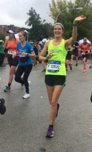 A Team CIF runner smiling on the Chicago Marathon course 2018