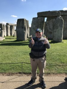 Jonathan standing in front of Stonehenge