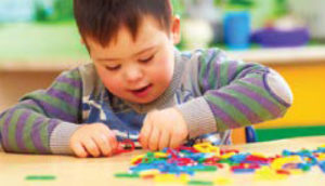 Student playing with puzzle pieces in colorful classroom setting