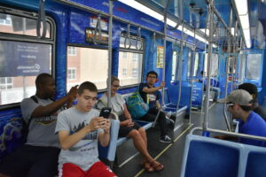 Travel the Town students exploring on the 'El' train