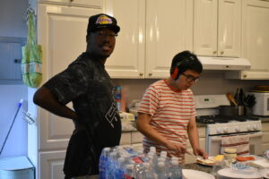Two students prepare lunch at Hub 930.