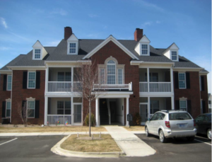 A large brown and white community housing option for individuals with disabilities.