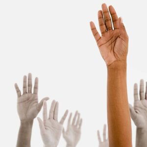 Hands raised in the air against a white background.