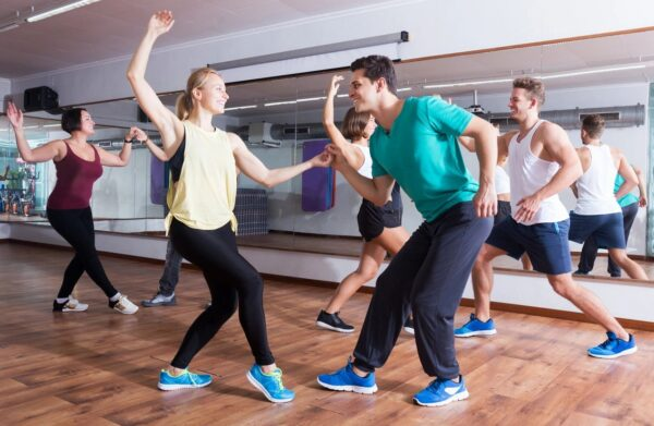 A group of people dancing in a dance studio.