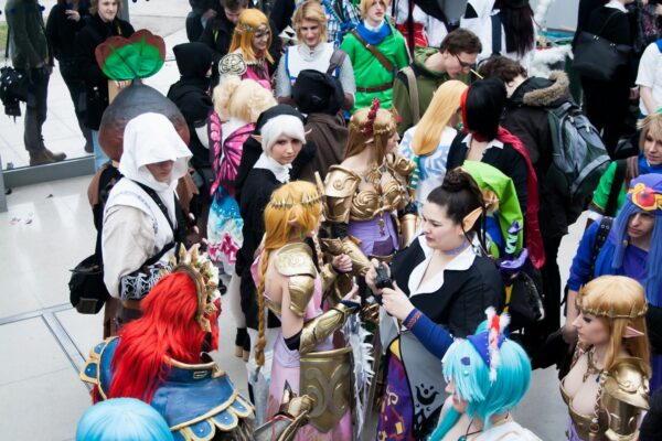 A crowd of people in costumes gather together.